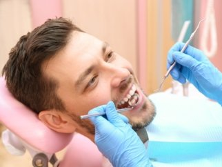 man smiling at the dentist
