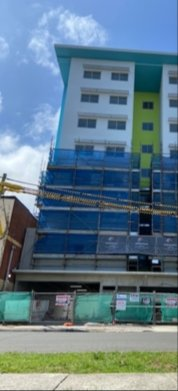 Scaffolding built around an apartment block in Auburn, Sydney ready to be reconstructed
