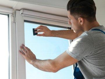 Window Tinting Blacktown worker applying tint onto a window