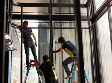 A team of window tinters from Blacktown preparing and cleaning windows to start installing tint on them