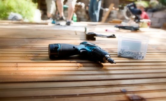 Tools and materials placed upon wooden flooring