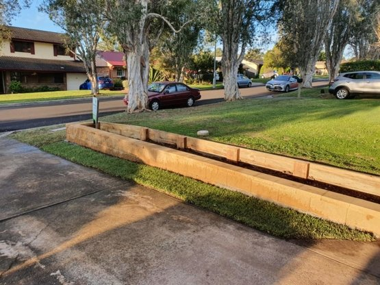 Double Retaining wall made of brick and timber parallel to a driveway in the Southern Highlands, NSW. Built by Clarkies Carpentry & Construction