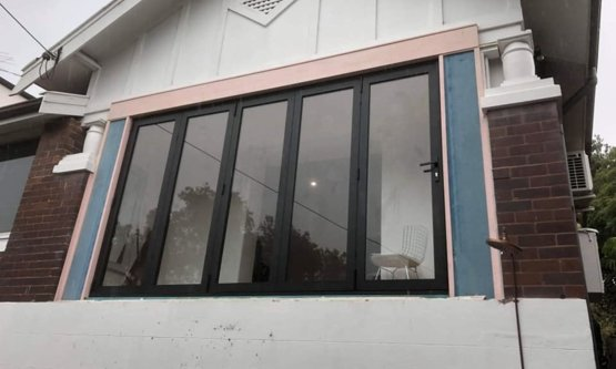 New french style windows with black trimmings and a lock on the inside