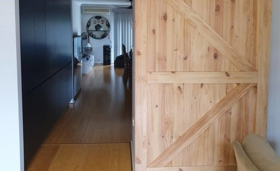 Barn door opened to reveal the inside of a home. Built by Clarkies Carpentry