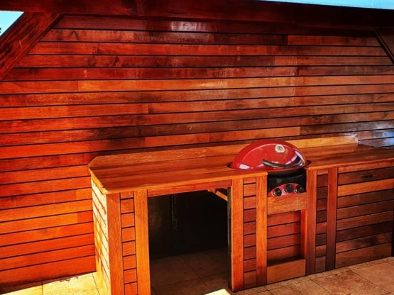 Outdoor kitchen and barbecue area constructed of wood by Clarkies Carpentry