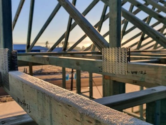 Artistic close up photo of timber framing with ice on it near Goulburn, NSW