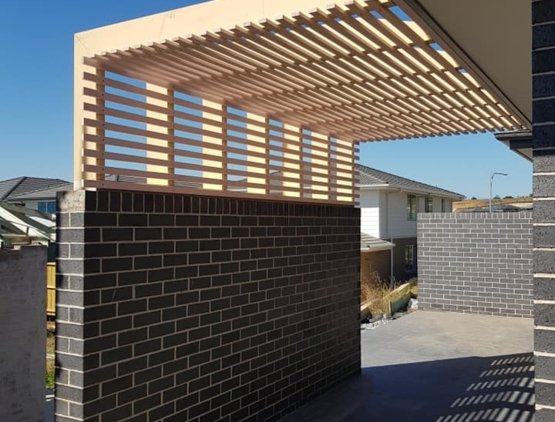 Stylish Pergola with a timber slatted design and brick as a foundation