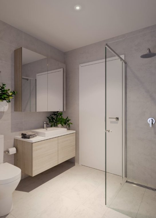 Modern Sydney bathroom with glass shower screen in the corner of the bathroom
