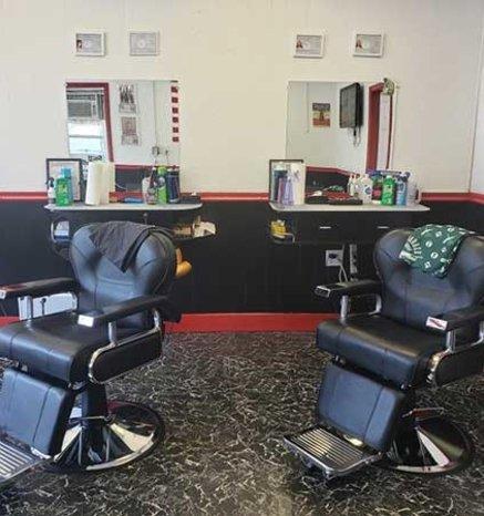 Gentlemens Club inside of Barbershop image of barbering chairs