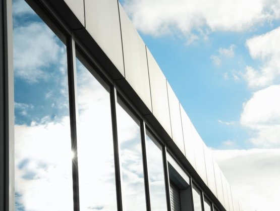 Exterior shot of office windows with dark tinting