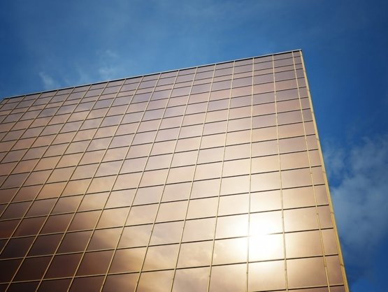 Shot of Sydney office windows with the sun reflecting off the tinted windows