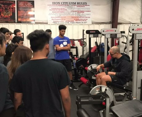 Coach Ryan group training and educating about working out, fitness, and health.